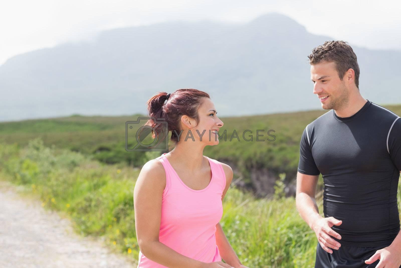 Athletic couple taking a break from jogging by Wavebreakmedia