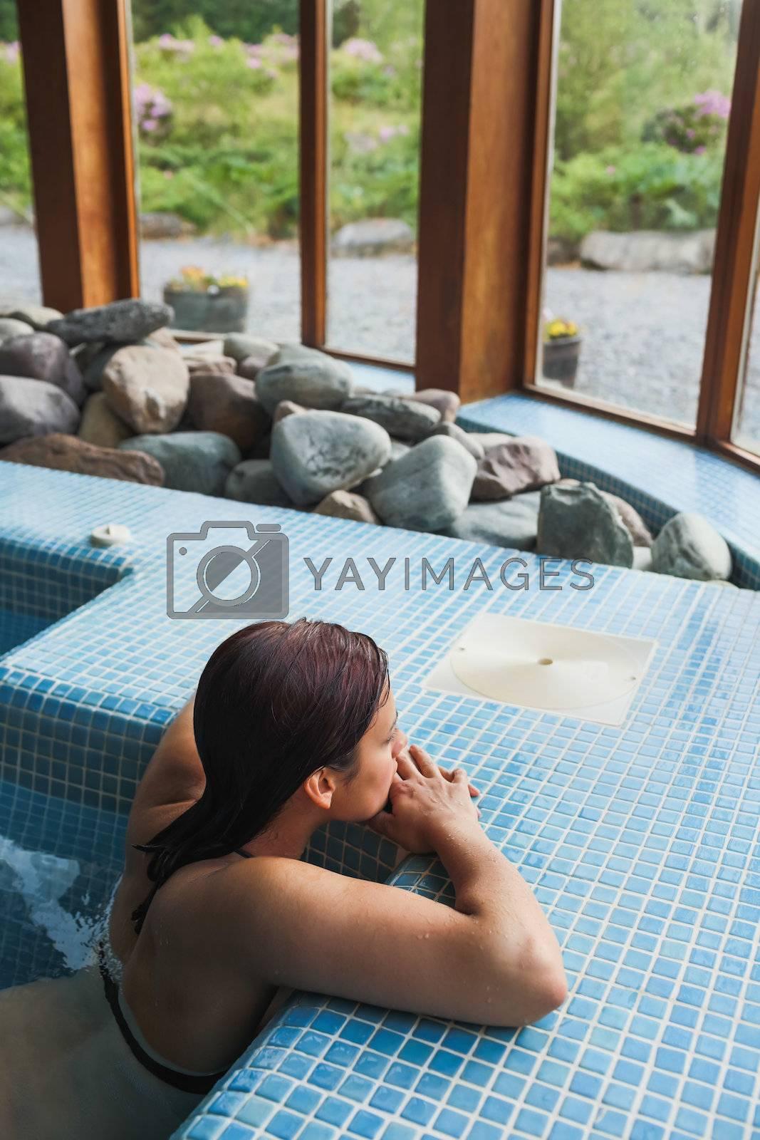 Brunette relaxing in a jacuzzi by Wavebreakmedia