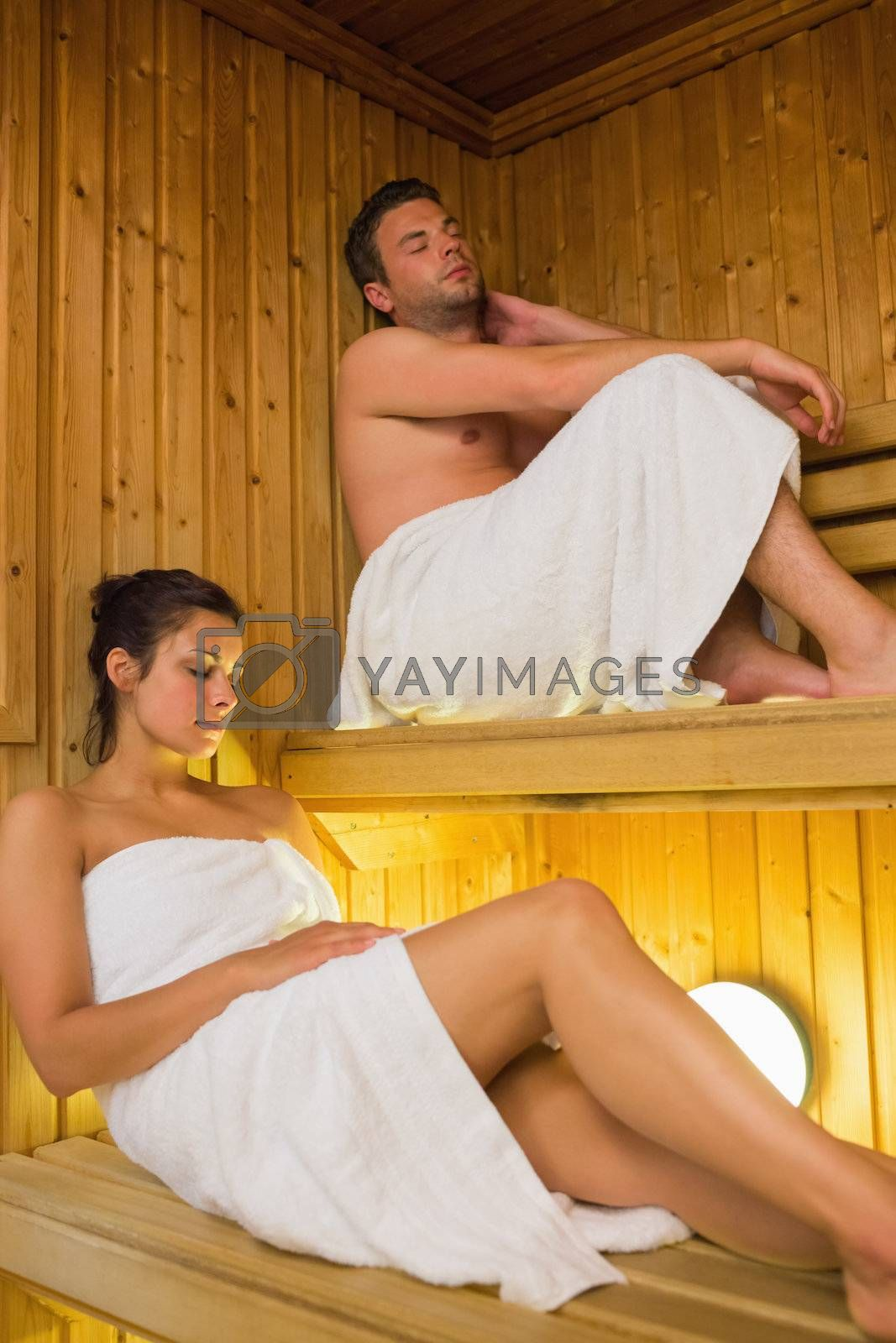 Content couple relaxing in a sauna by Wavebreakmedia