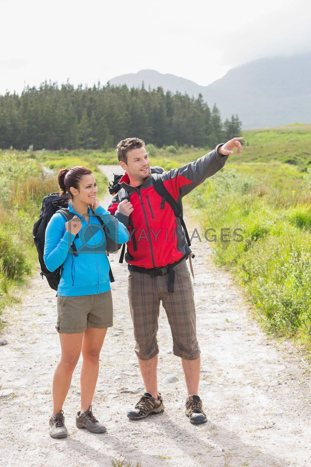 Hikers with backpacks standing on country trail by Wavebreakmedia