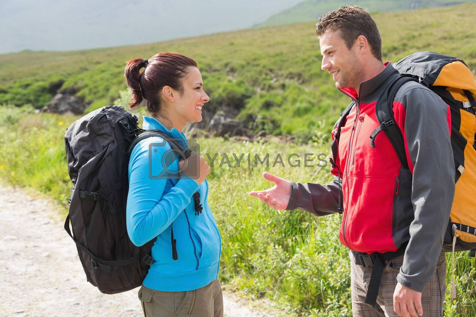 Hikers with backpacks chatting together by Wavebreakmedia