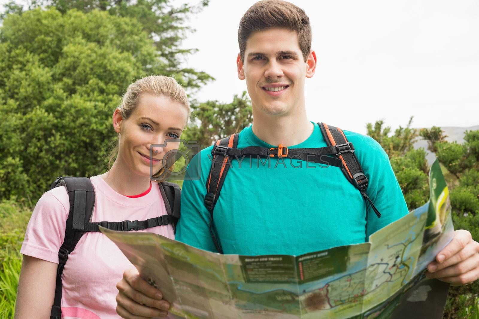 Athletic couple holding map on a hike by Wavebreakmedia