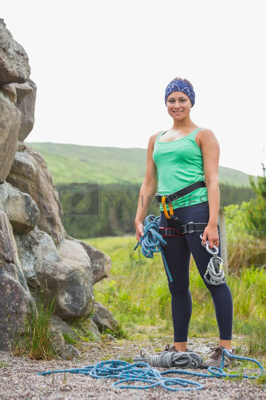 Attractive rock climber smiling at camera by Wavebreakmedia