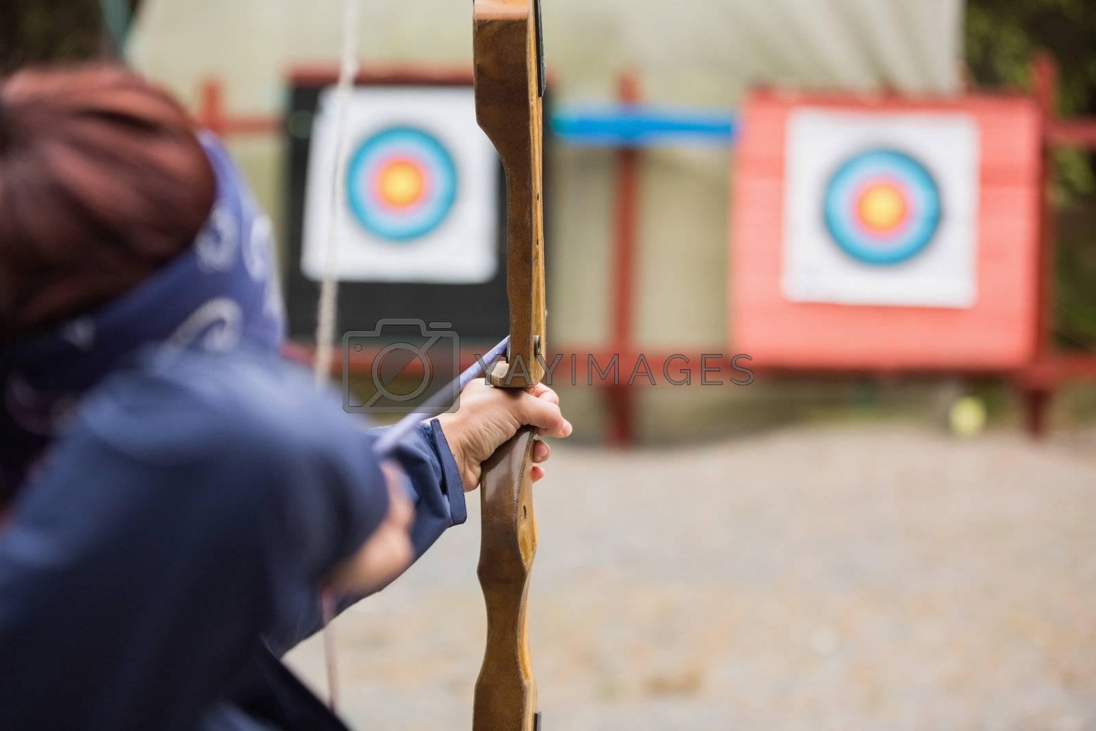 Brunette about to shoot arrow by Wavebreakmedia