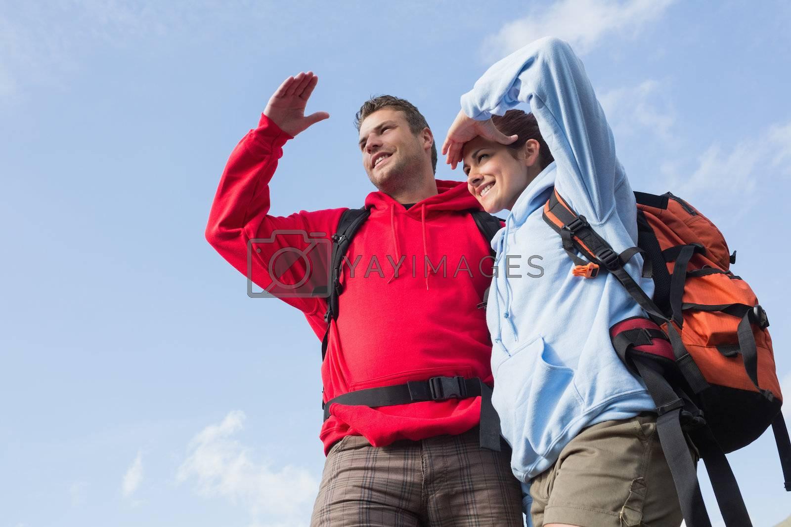 Couple on a hike looking ahead by Wavebreakmedia