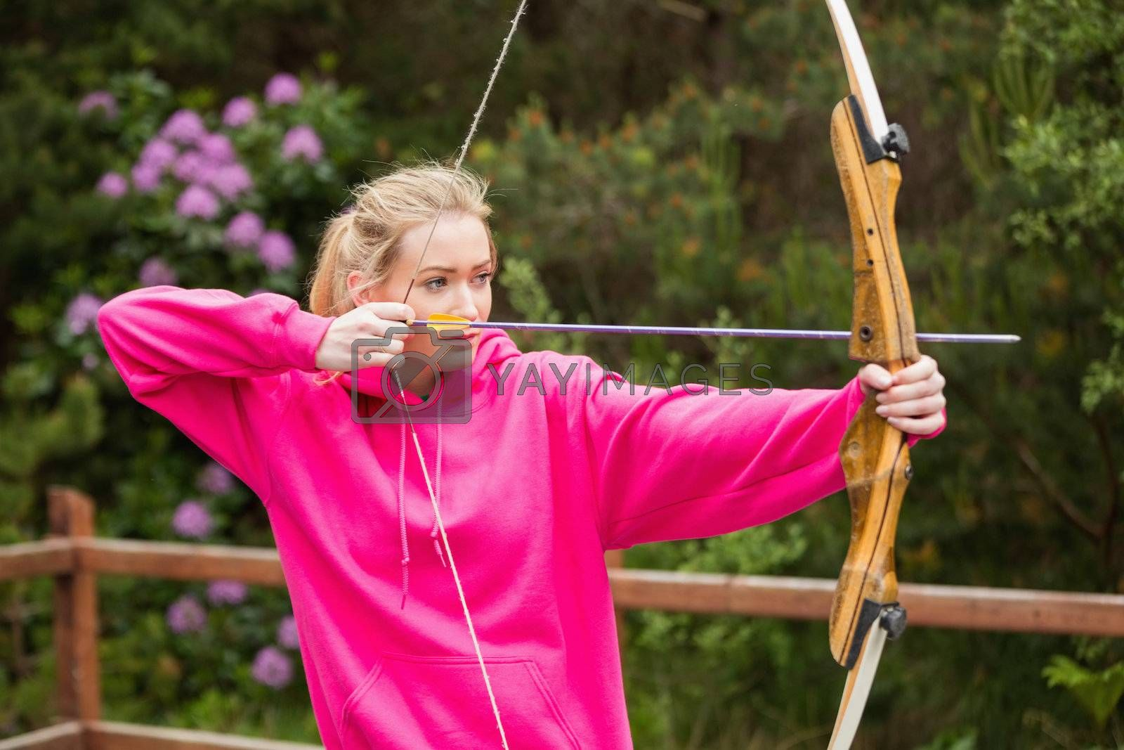 Concentrating blonde practicing archery by Wavebreakmedia