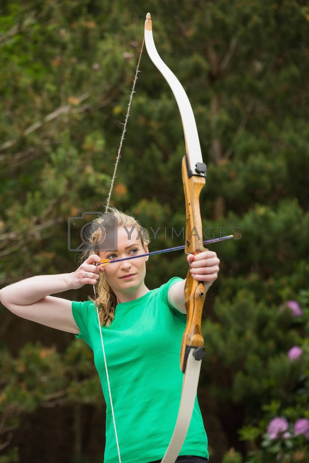 Concentrating blonde woman practicing archery by Wavebreakmedia