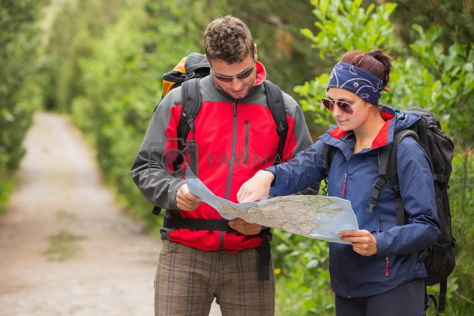 Couple going on a hike together looking at map by Wavebreakmedia