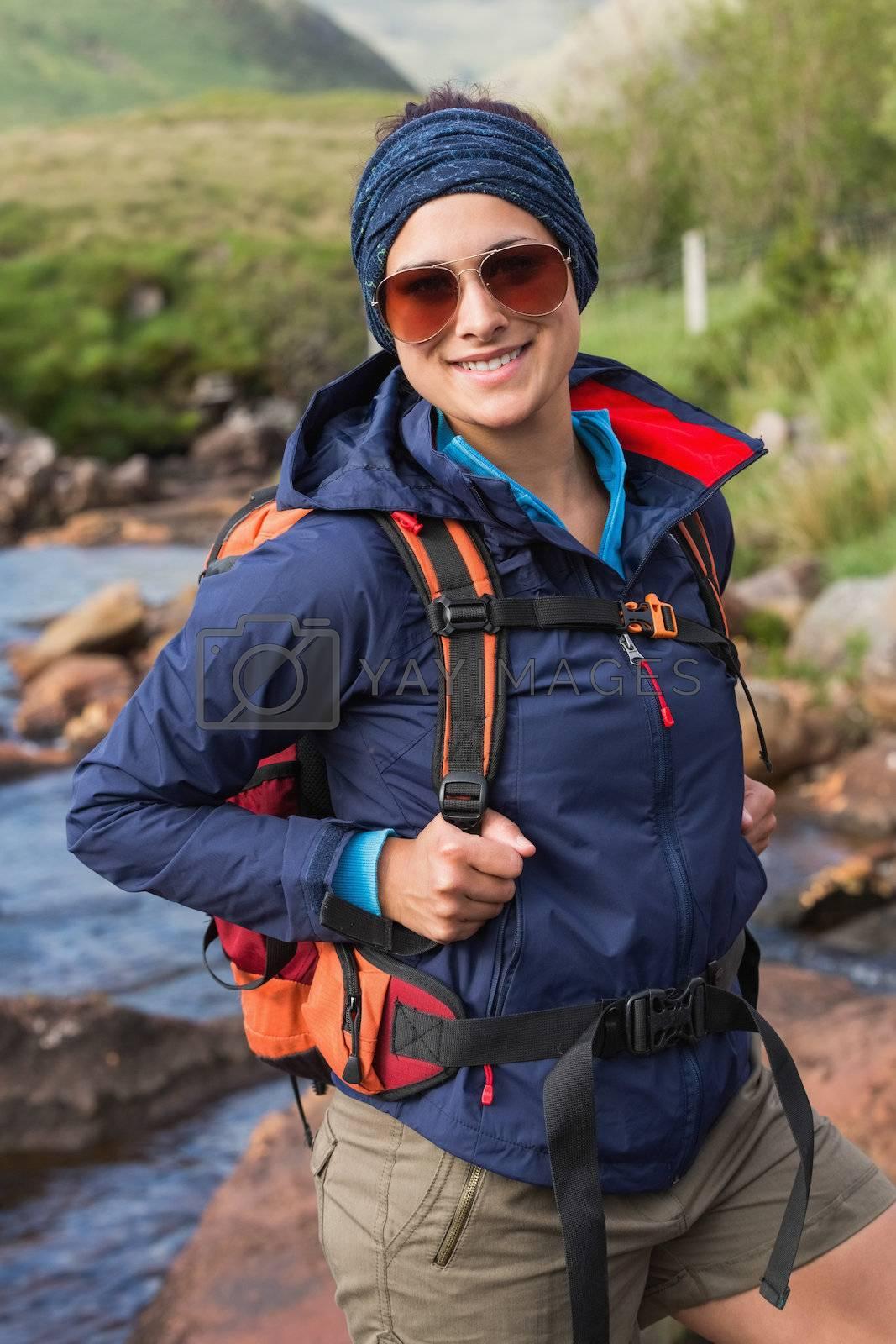 Sporty brunette on a hike by Wavebreakmedia