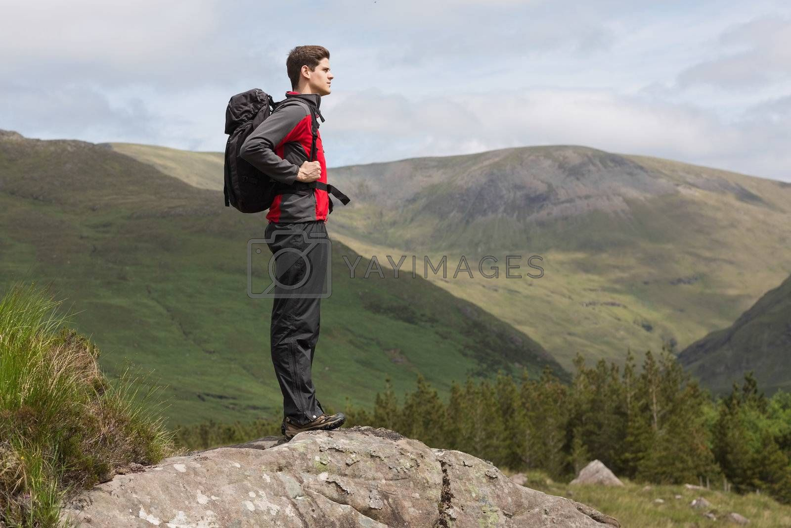 Man standing at hill top admiring the view by Wavebreakmedia