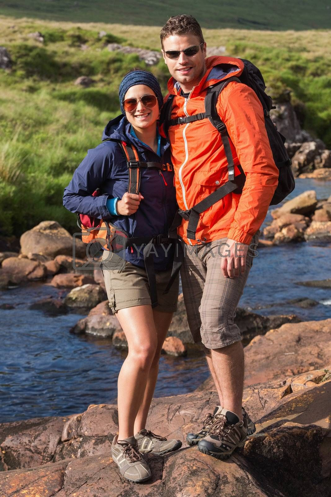 Smiling couple on a hike by Wavebreakmedia