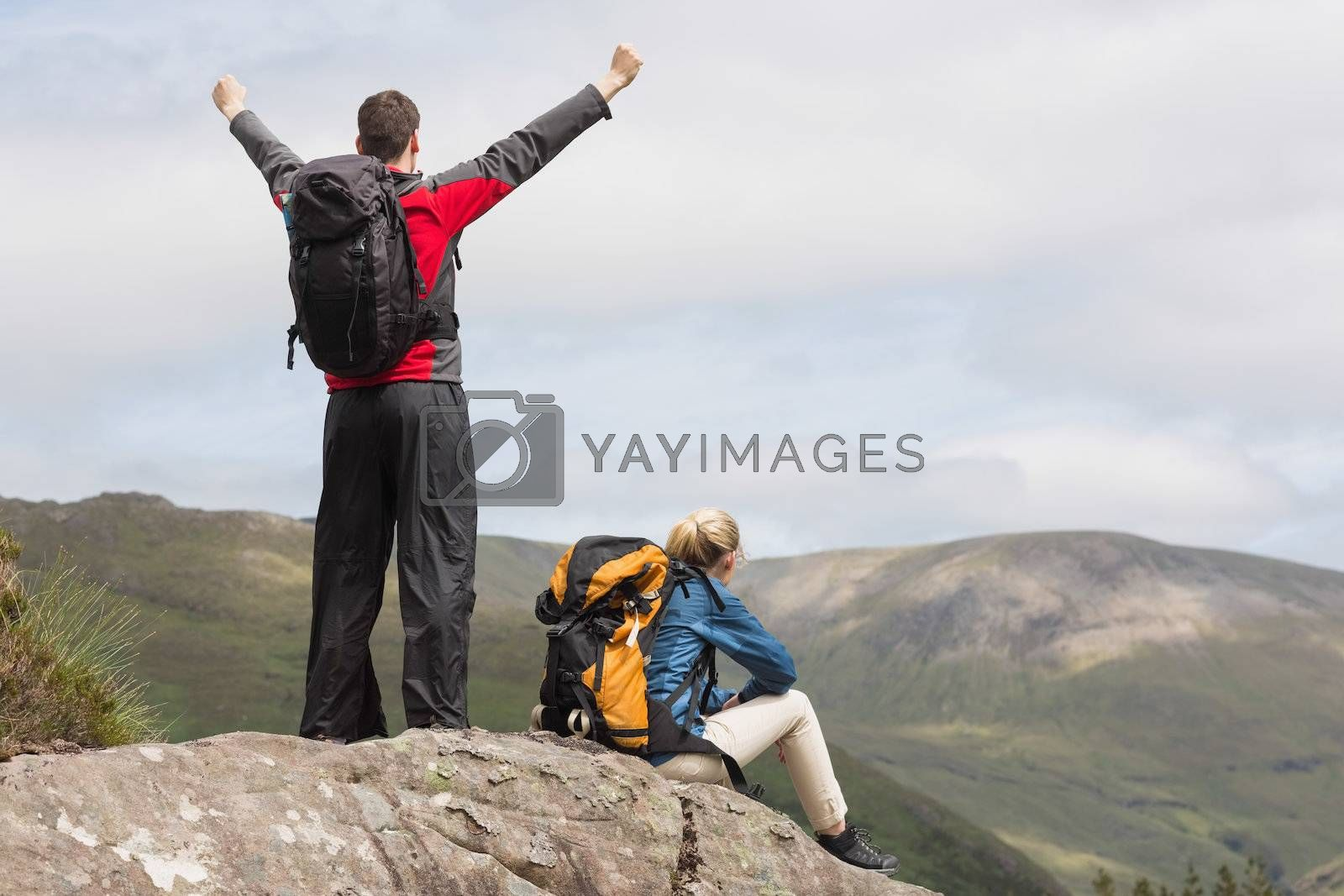 Couple reaching the top of their hike by Wavebreakmedia