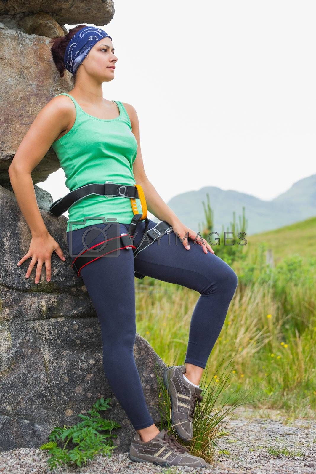Attractive female rock climber leaning on rock face by Wavebreakmedia