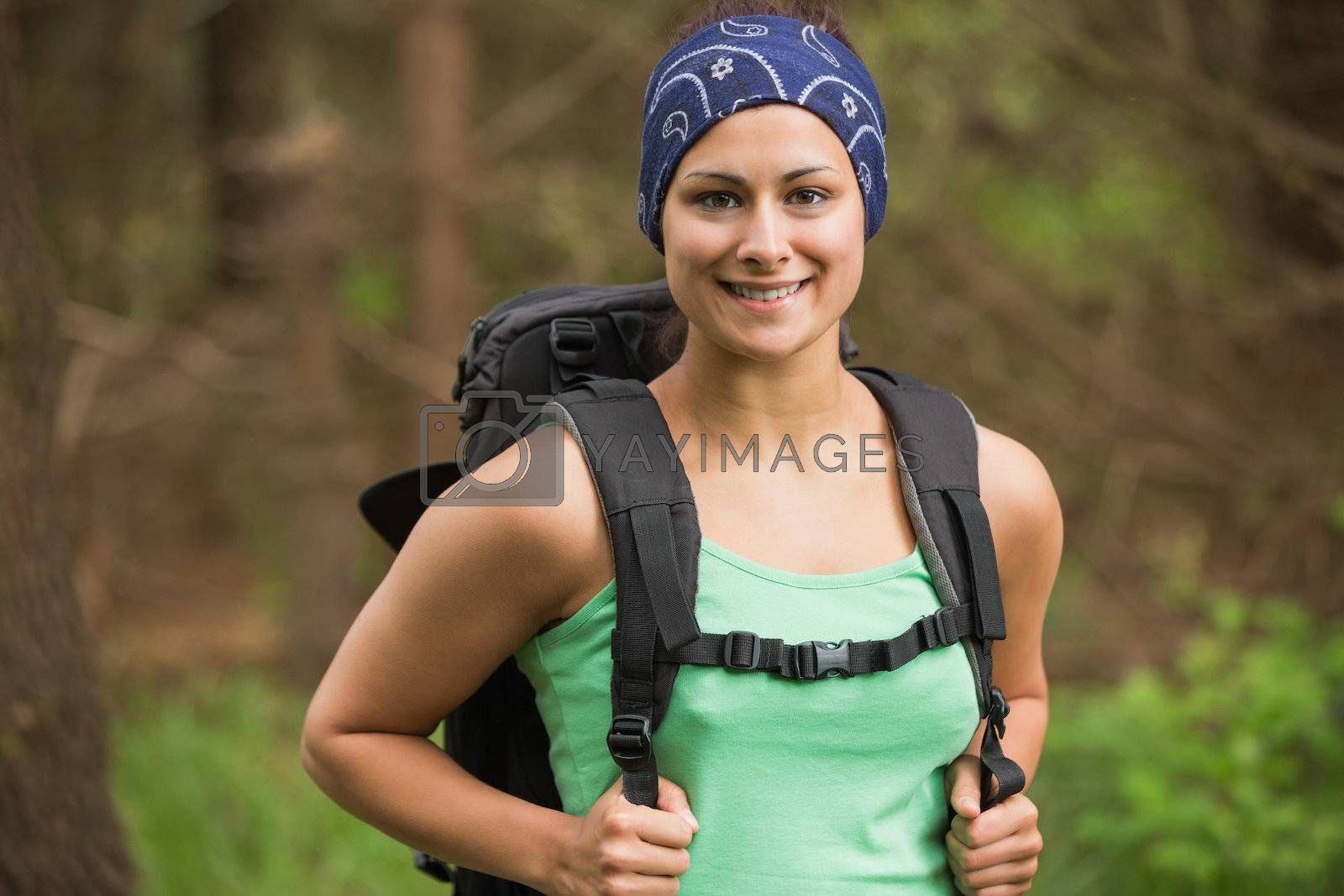 Smiling woman standing in a forest by Wavebreakmedia