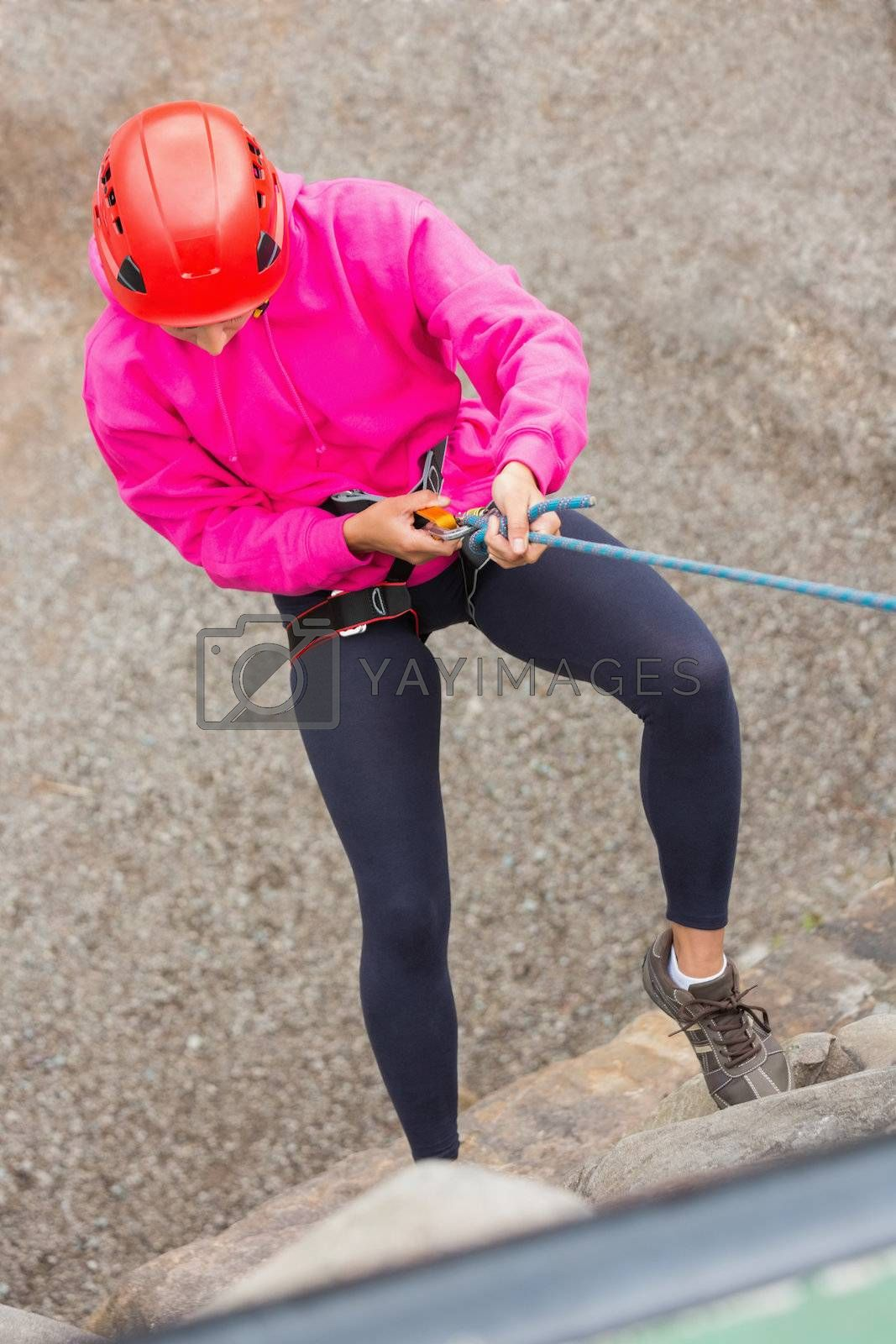 Fit girl abseiling down rock face by Wavebreakmedia