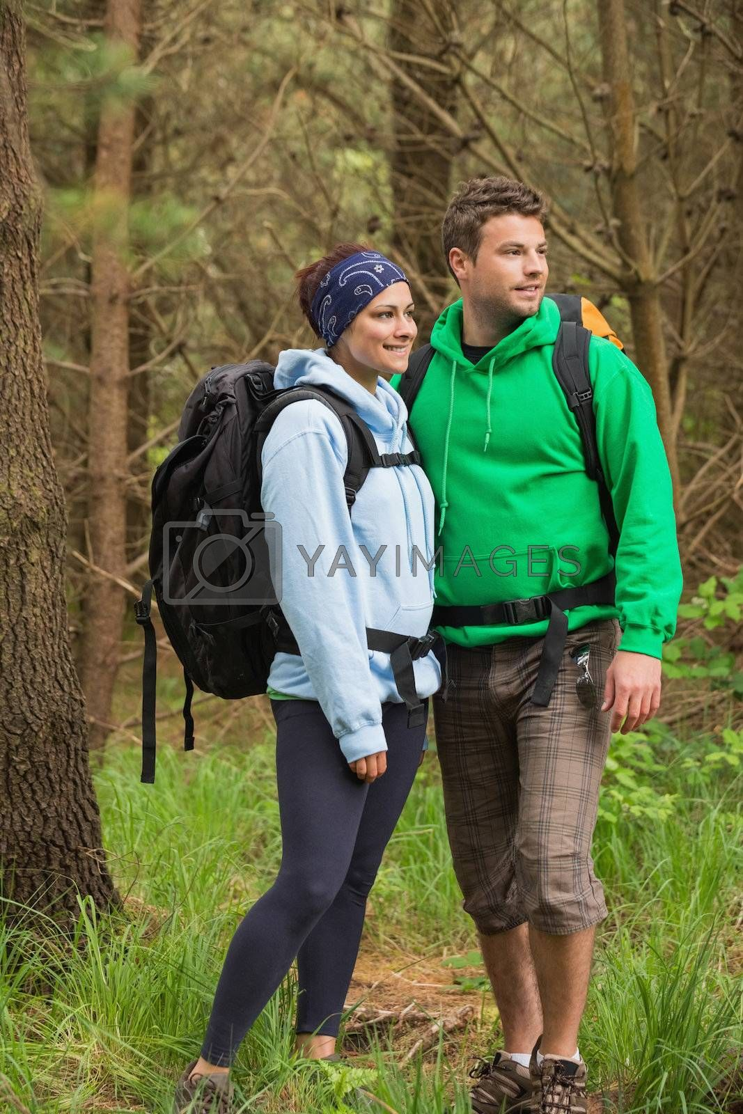 Smiling couple standing in a forest by Wavebreakmedia