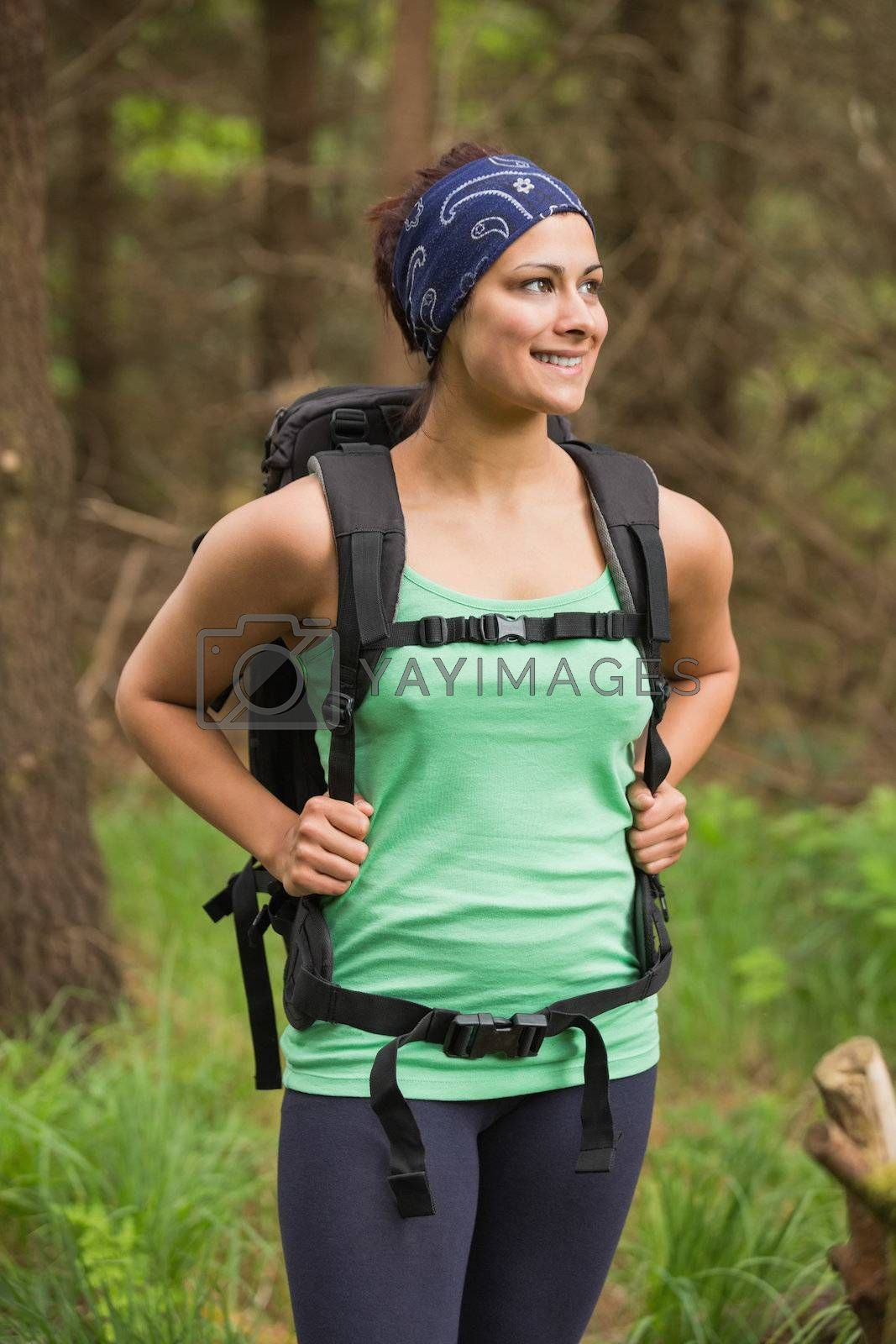 Radiant woman standing in a forest on a hike by Wavebreakmedia