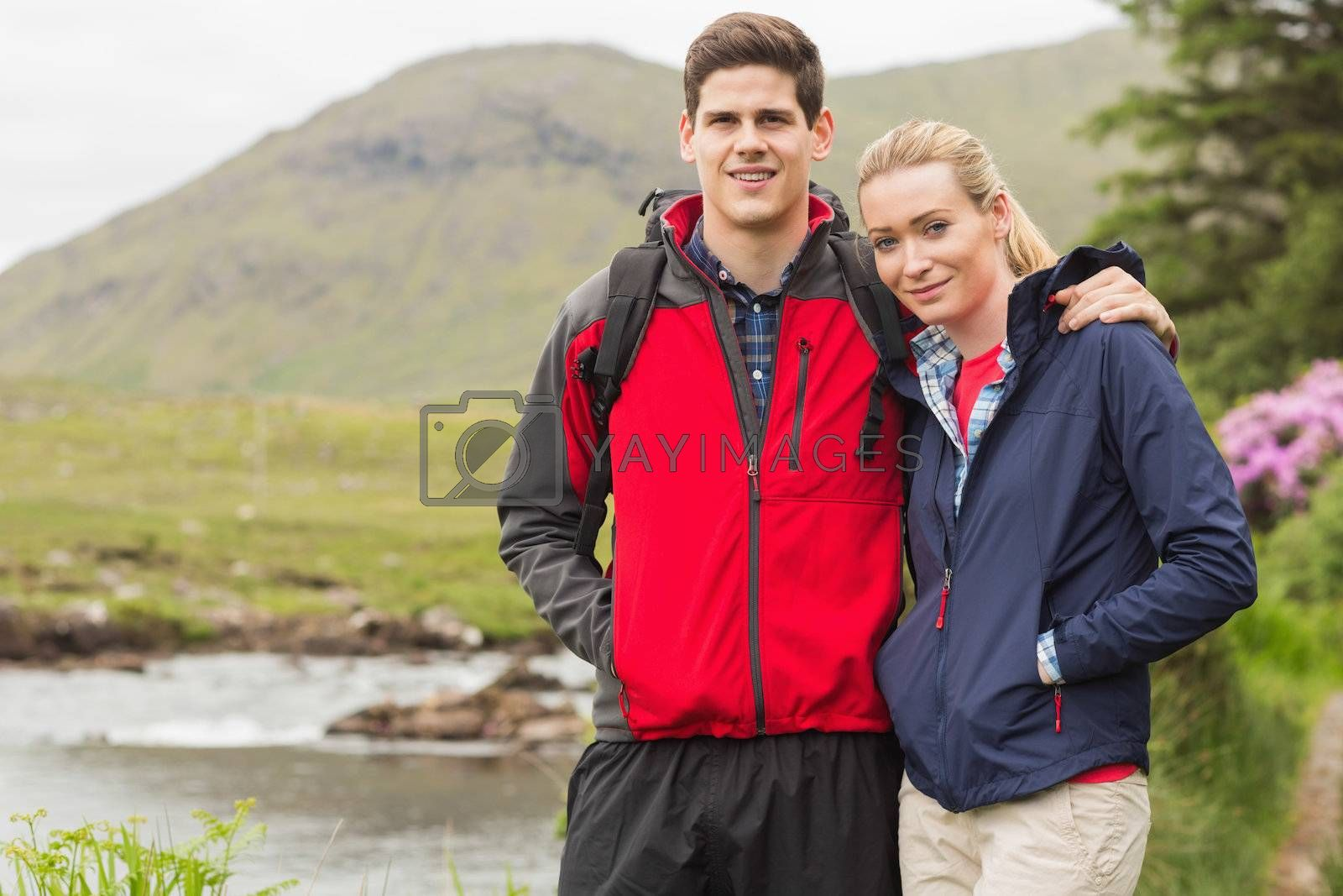 Fit couple on a hike by Wavebreakmedia