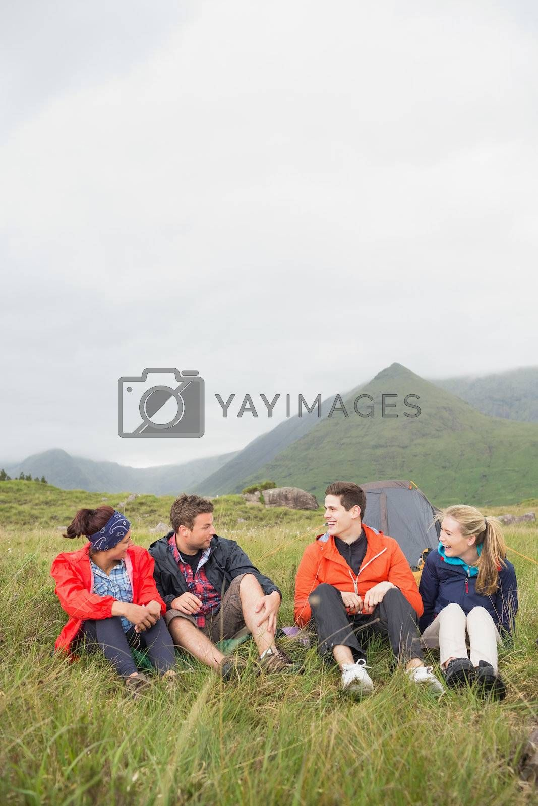 Friends talking together on a camping trip by Wavebreakmedia