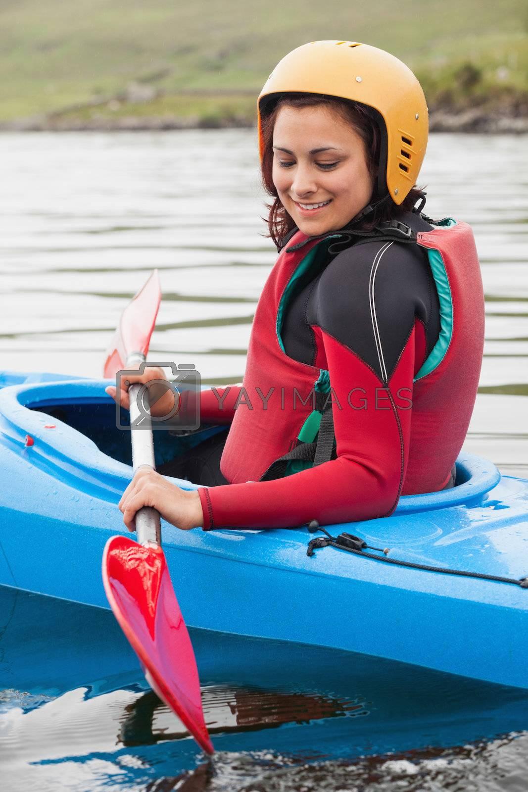 Fit woman rowing on lake by Wavebreakmedia