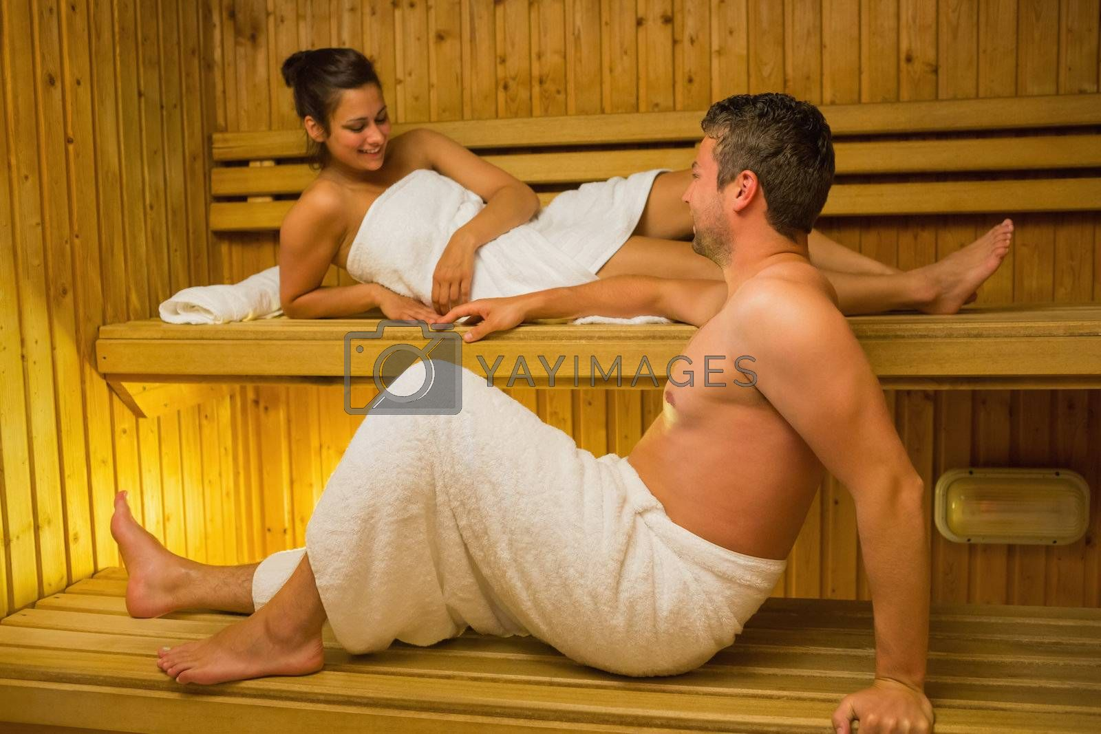 Calm couple relaxing in a sauna and chatting by Wavebreakmedia