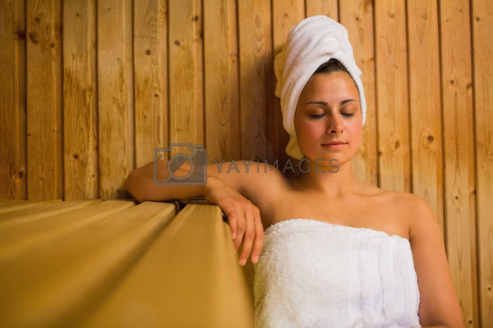 Calm woman relaxing in a sauna by Wavebreakmedia