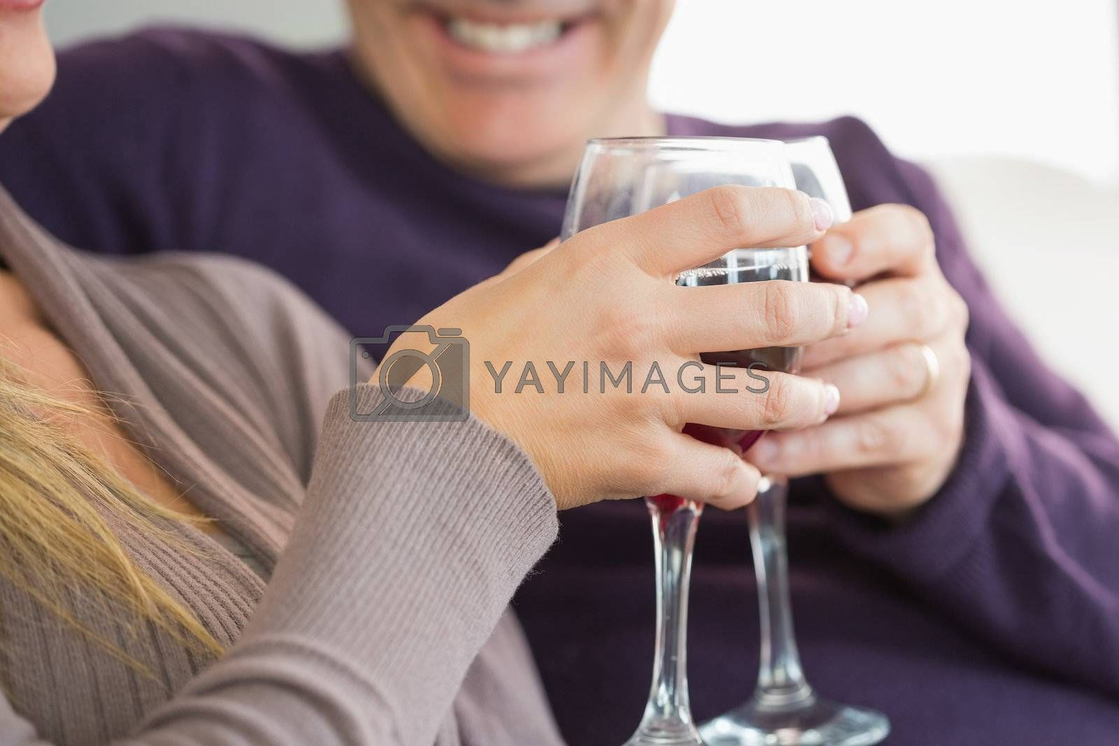Smiling couple toasting with wine by Wavebreakmedia