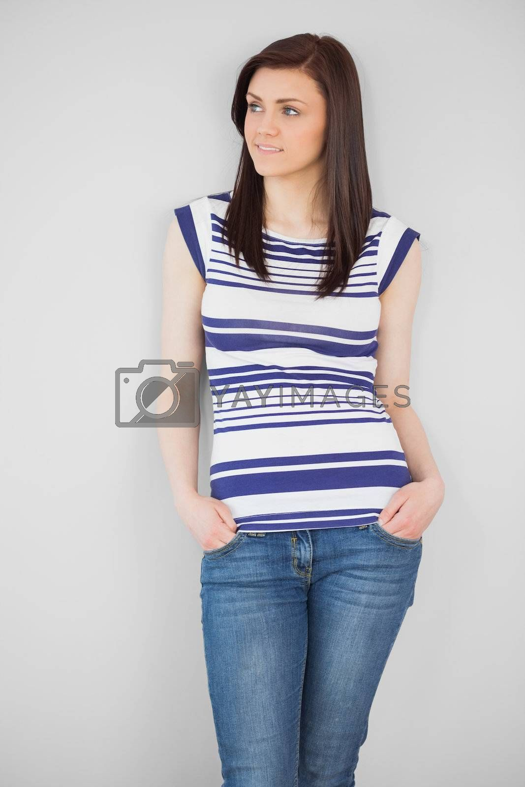 Stylish girl standing and looking away by Wavebreakmedia