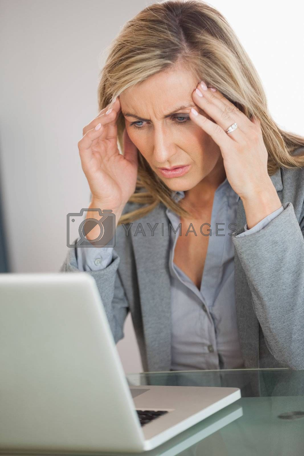 Stressed businesswoman trying to use her laptop by Wavebreakmedia