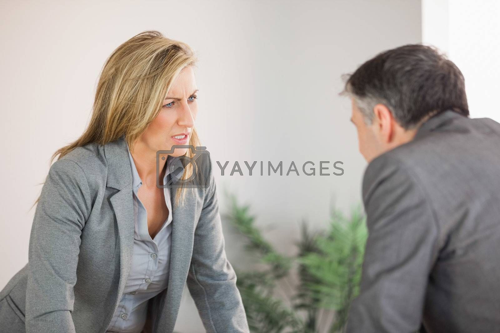 Colleagues arguing in an office by Wavebreakmedia