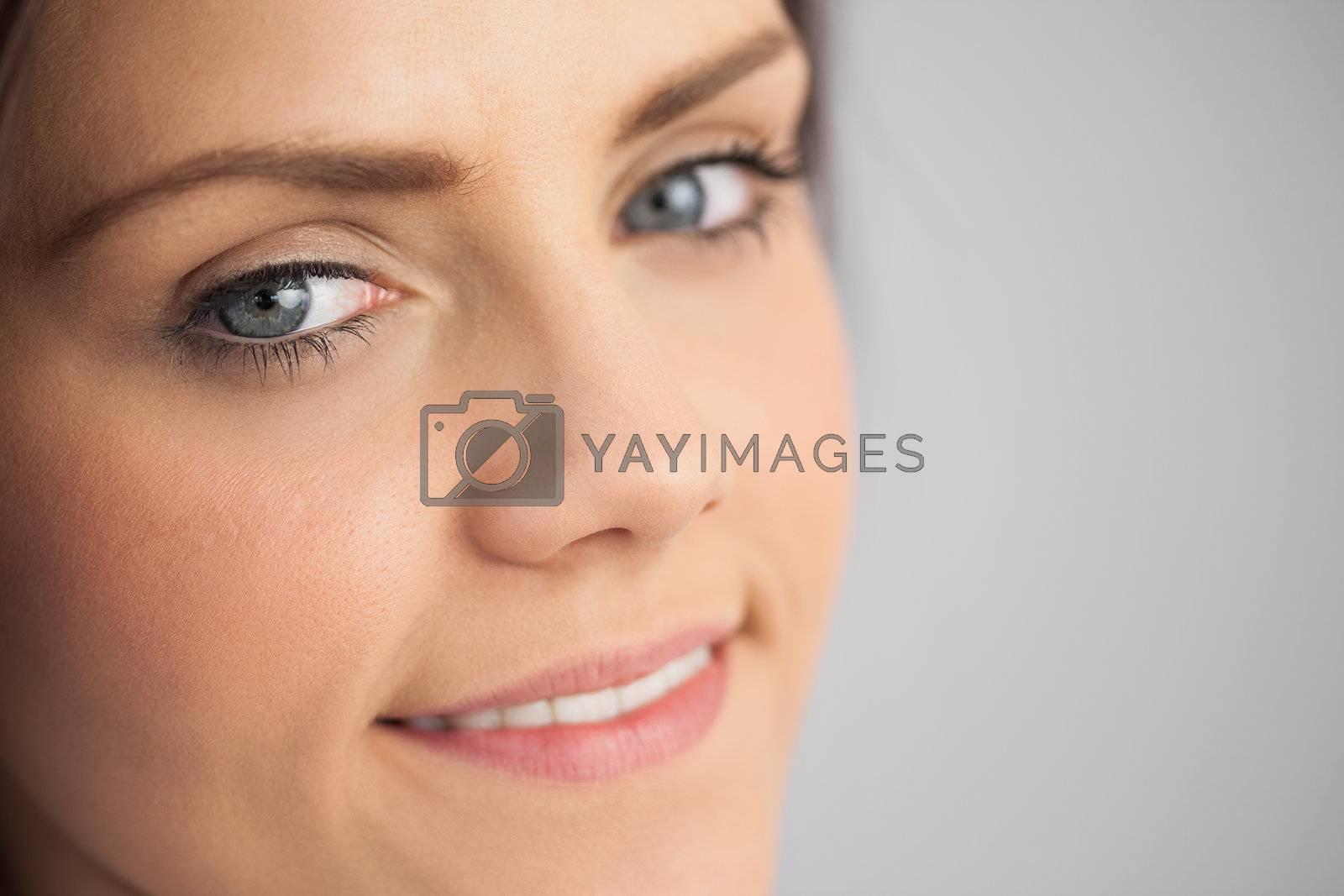 Smiling brunette looking  by Wavebreakmedia