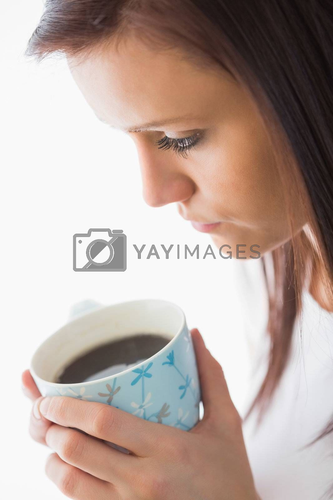 Peaceful girl holding a cup of coffee by Wavebreakmedia