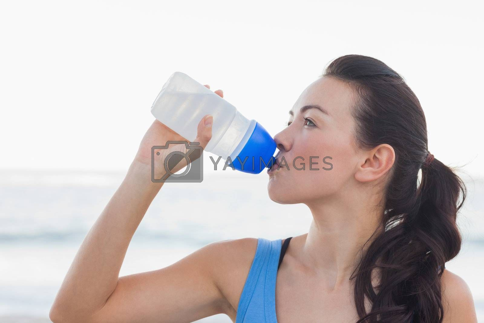 Woman drinking after exercising by Wavebreakmedia