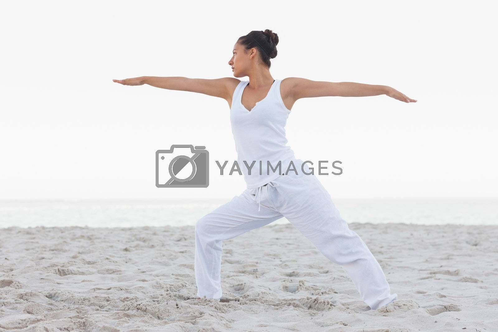 Brunette woman stretching in yoga pose by Wavebreakmedia