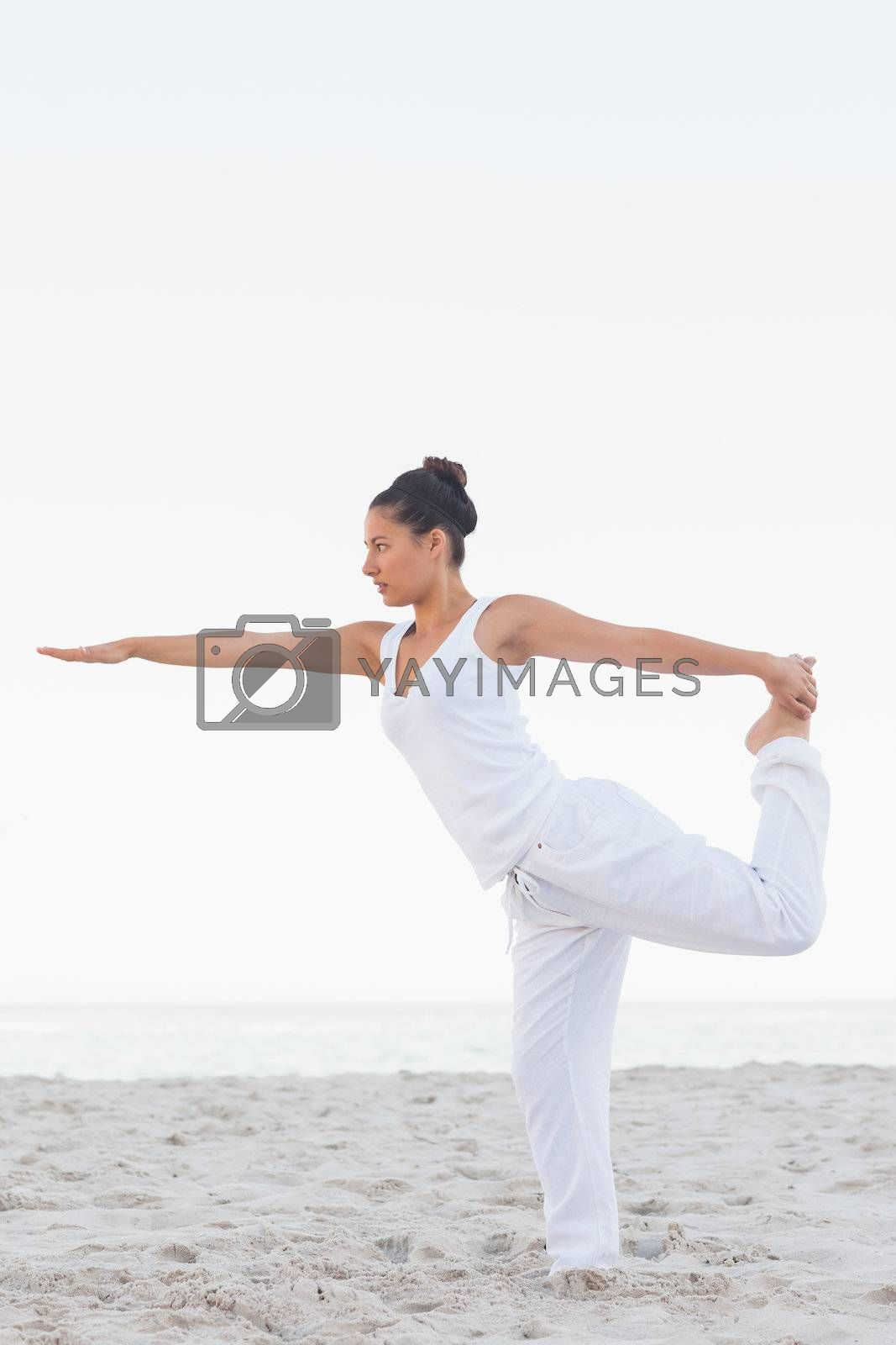 Woman in lord of the dance yoga pose by Wavebreakmedia
