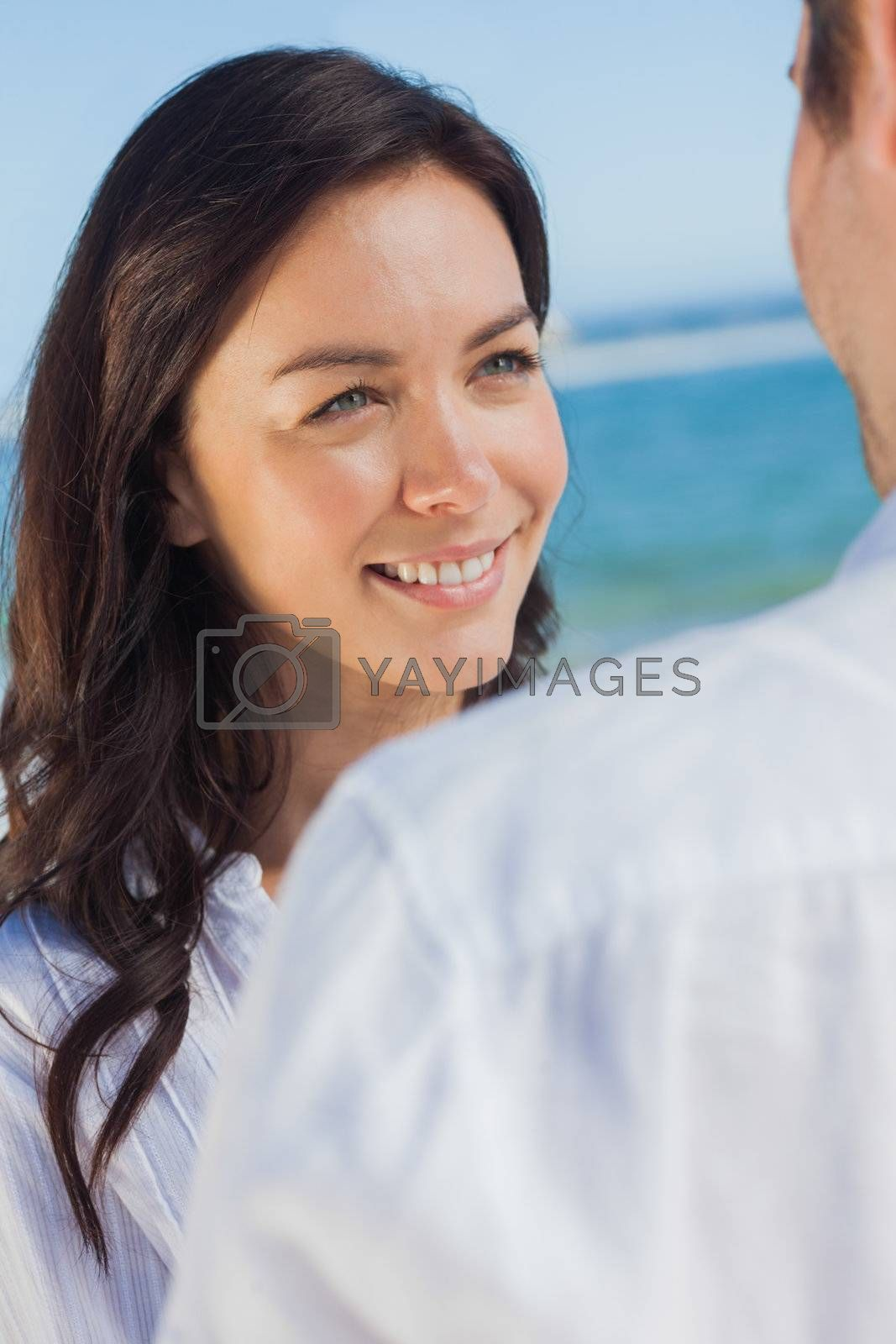 Happy woman smiling at her parnter by Wavebreakmedia