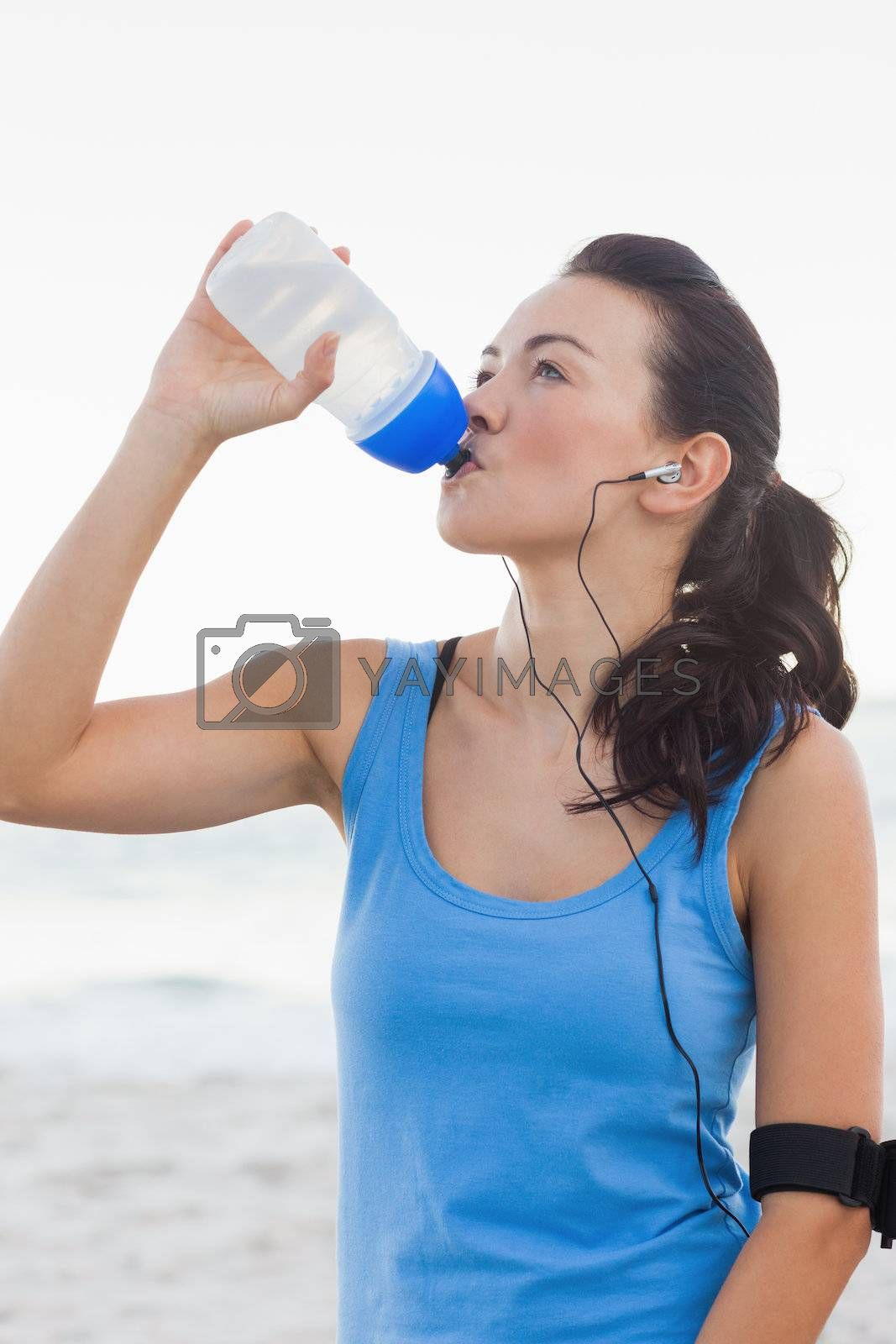 Woman drinking bottled water after doing sports by Wavebreakmedia