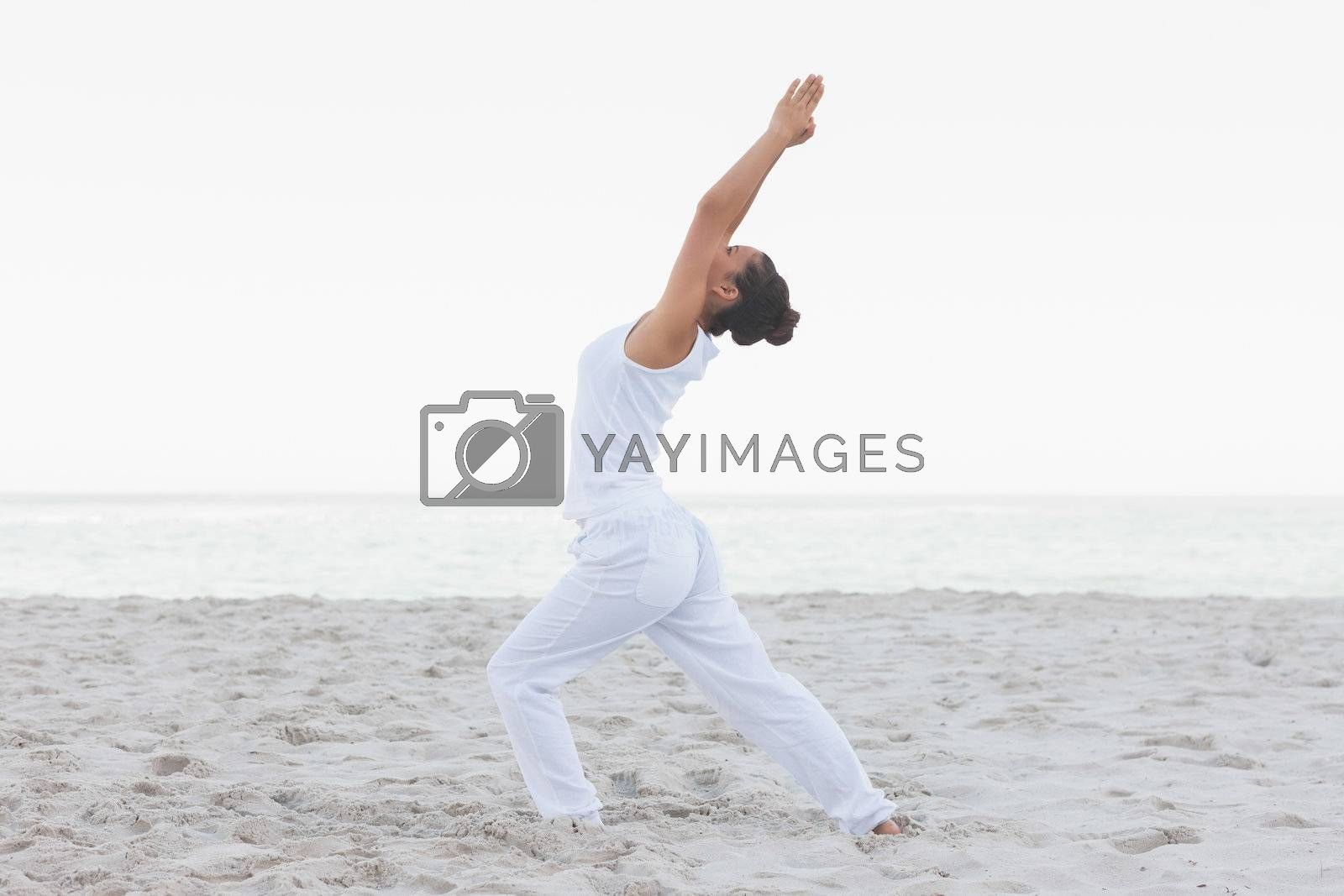 Woman in low lunge yoga pose by Wavebreakmedia