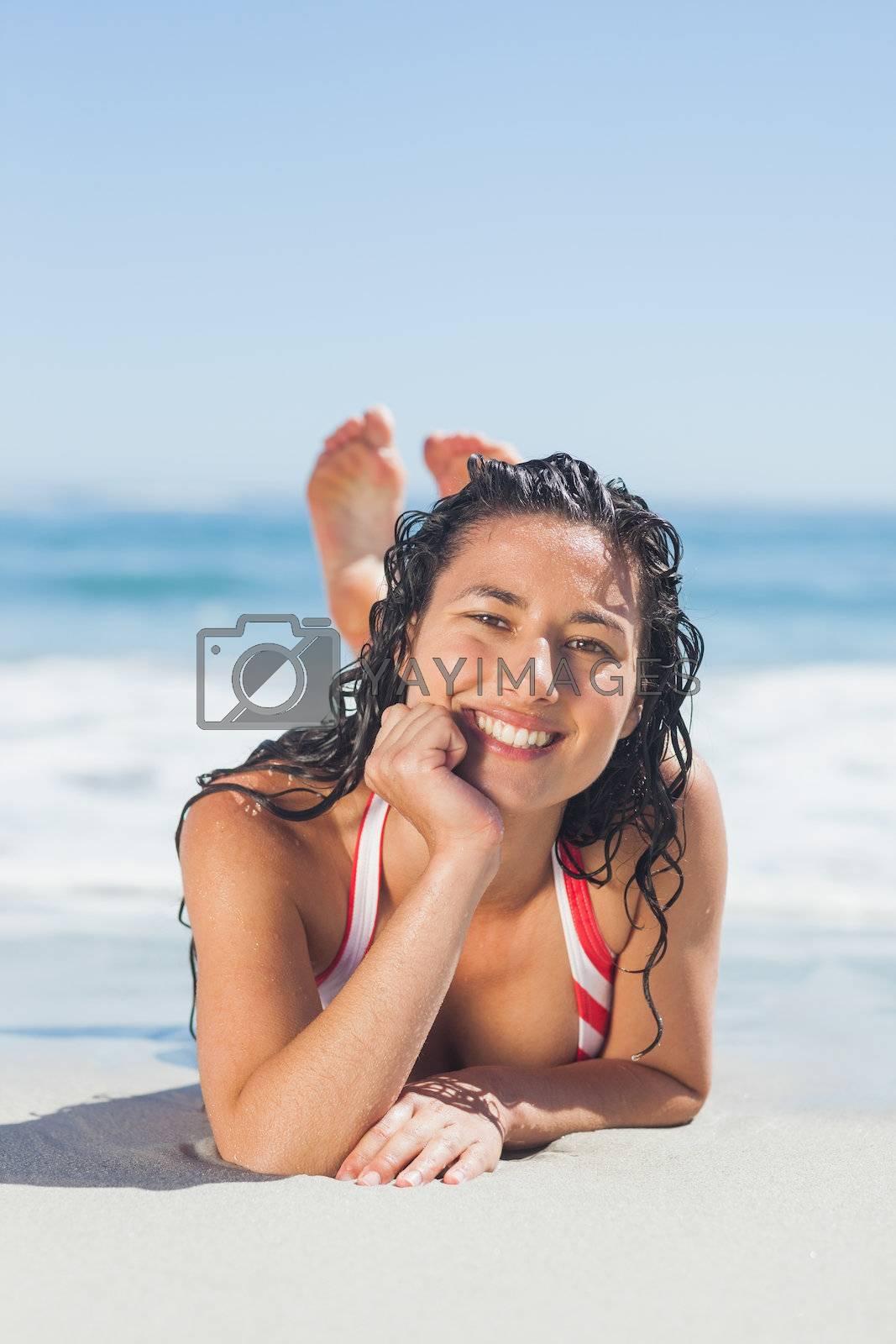 Attractive woman lying down  by Wavebreakmedia