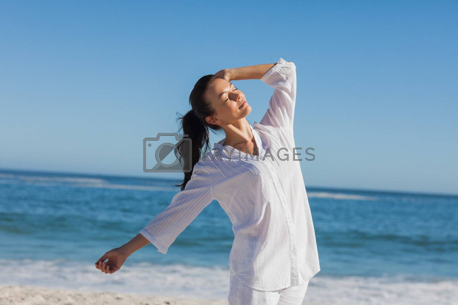 Attractive woman relaxing the sun by Wavebreakmedia