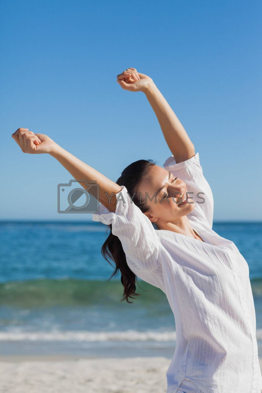 Brunette woman stretching by Wavebreakmedia