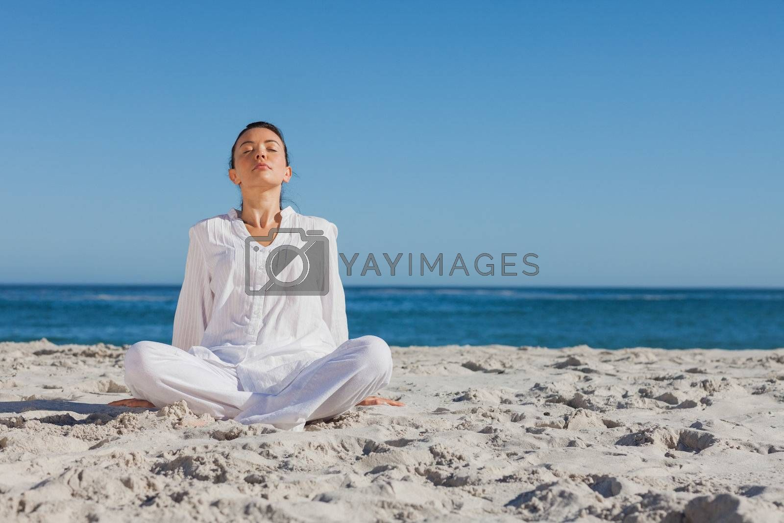 Peaceful woman sitting and relaxing by Wavebreakmedia