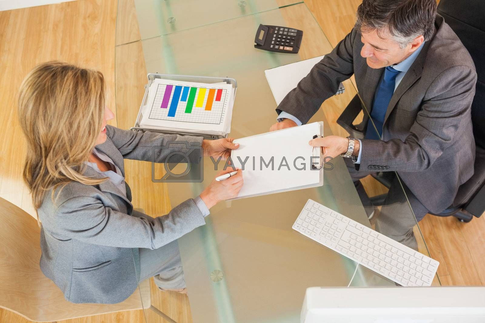 Two business people negociating in an office by Wavebreakmedia