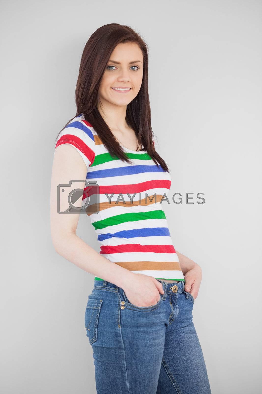 Smiling girl posing and looking at camera by Wavebreakmedia