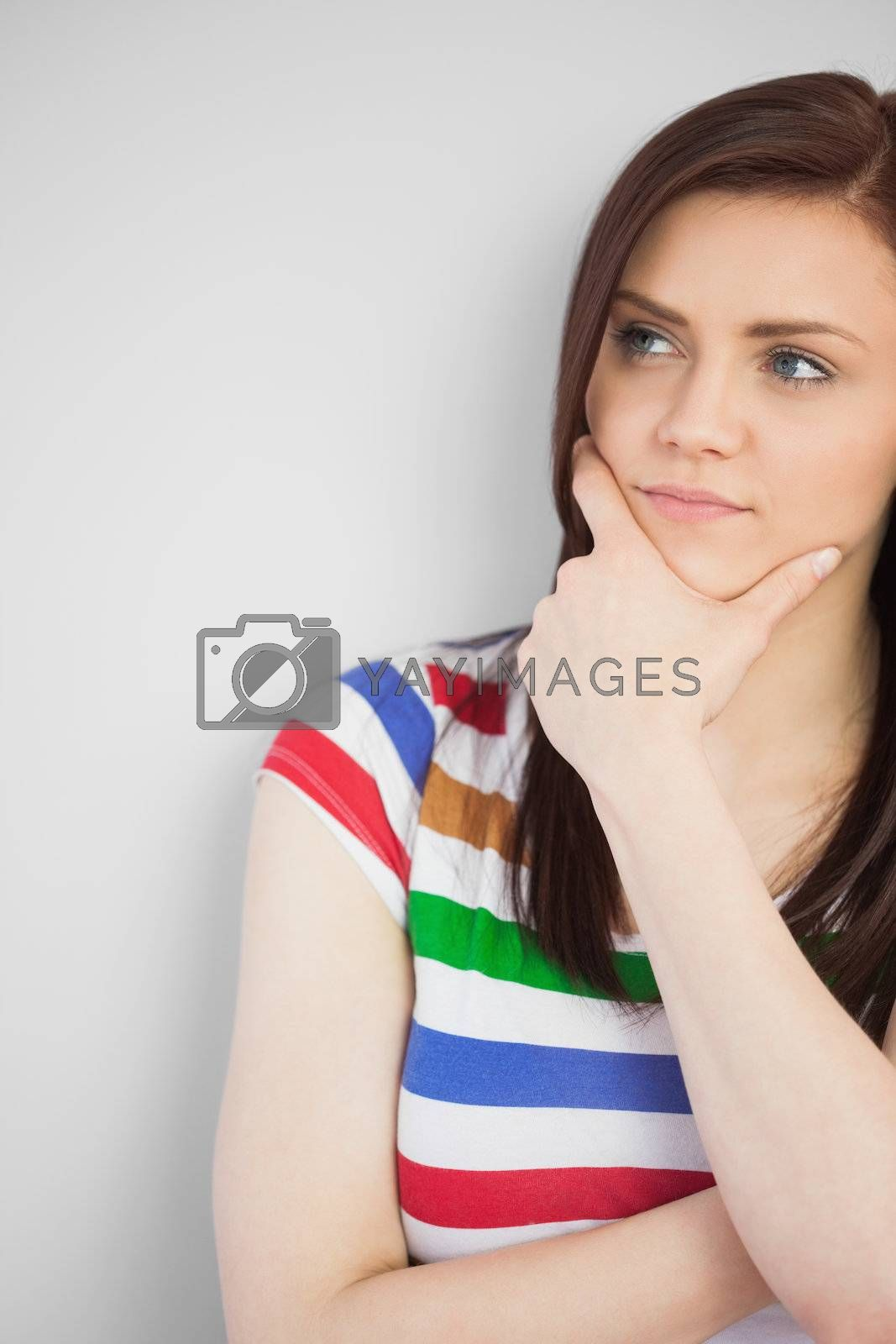 Thoughtful teen posing and looking away by Wavebreakmedia