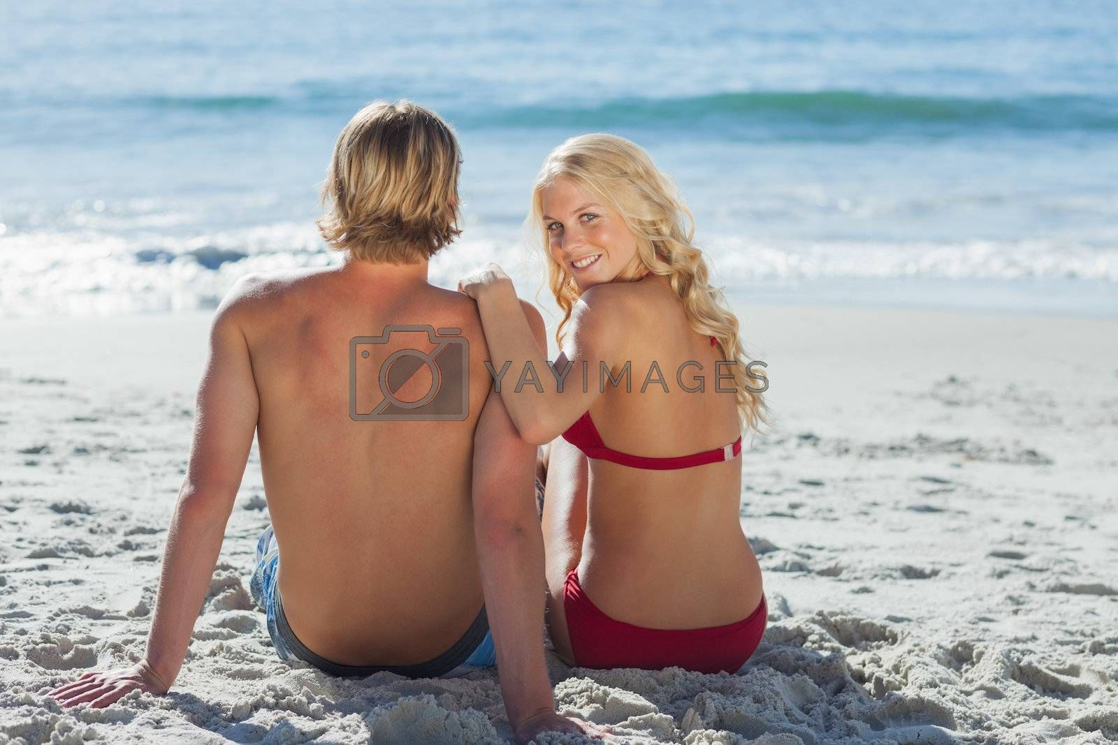 Rear view of couple on beach by Wavebreakmedia