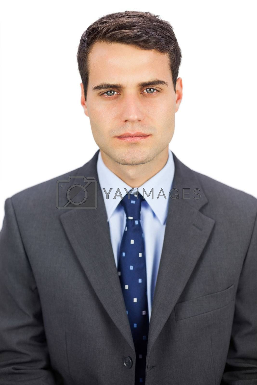 Serious businessman looking at camera by Wavebreakmedia