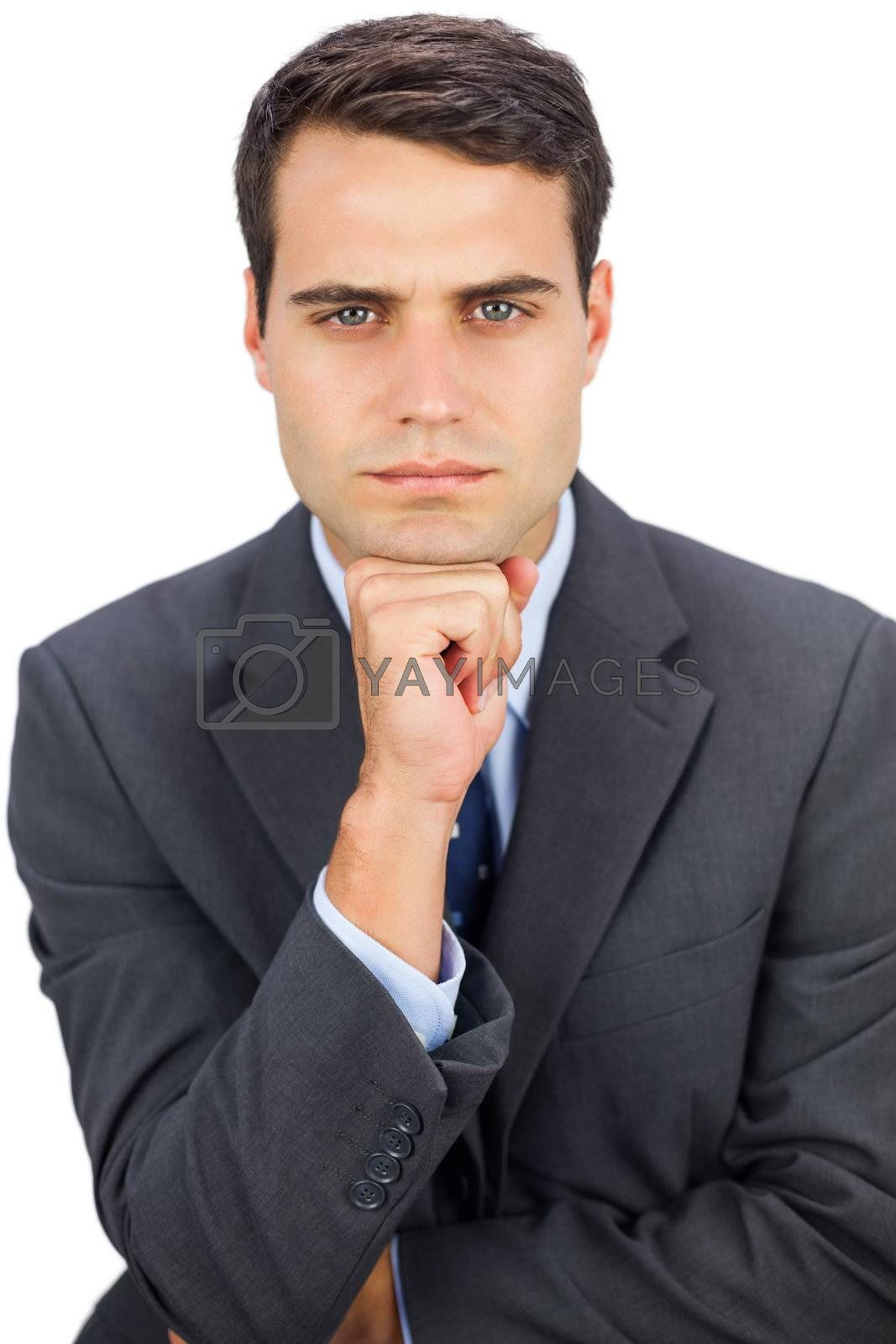 Frowning businessman looking at camera by Wavebreakmedia