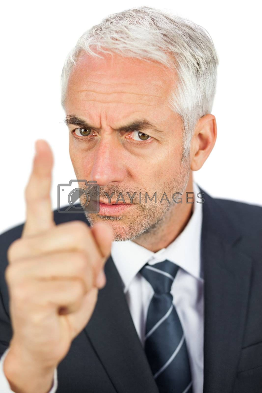 Angry businessman pointing his finger and looking  by Wavebreakmedia