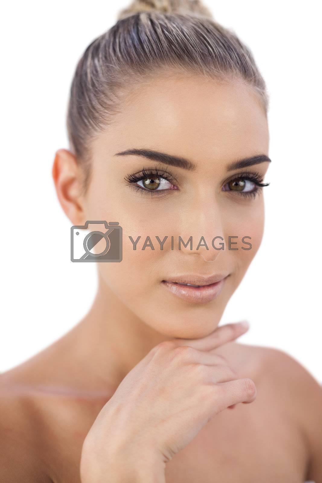 Pretty woman looking at camera by Wavebreakmedia